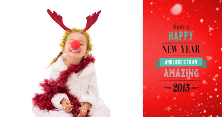 red nose: Cute little girl wearing red nose and tinsel against red vignette Stock Photo