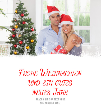 swapping: Happy couple at christmas against frohe weihnachten message