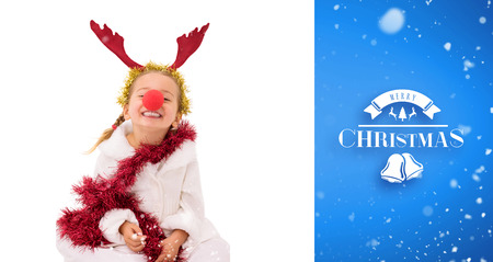 red nose: Cute little girl wearing red nose and tinsel against blue vignette