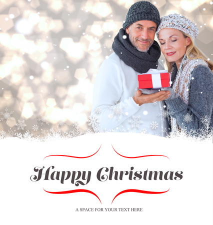 couple winter: happy winter couple with gift against border