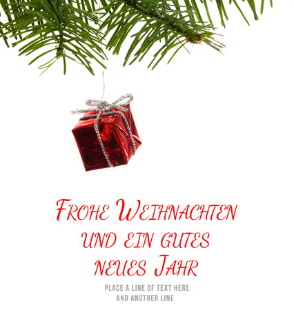 frohe: Frohe weihnachten message against red christmas decoration hanging from branch