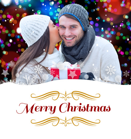couple winter: winter couple holding gift against border Stock Photo
