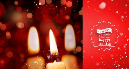 burning time: Snow falling against candle burning against festive background