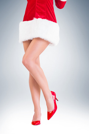 sexy santa girl: Lower half of sexy santa girl on vignette background