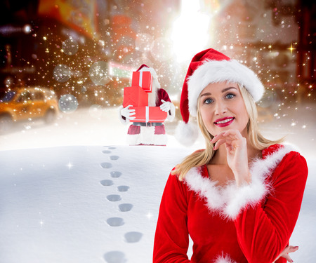 pere noel sexy: Festive blonde smiling at camera against santa delivering gifts in city