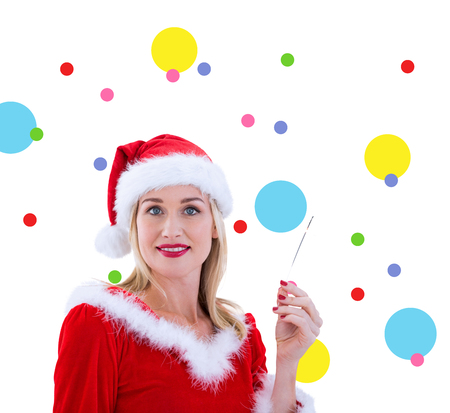 pere noel sexy: Festive blonds souriant � la cam�ra contre motif de points
