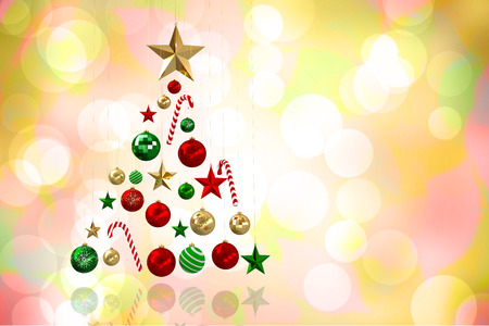 girly: Christmas tree shape of baubles against girly pink and yellow pattern Stock Photo