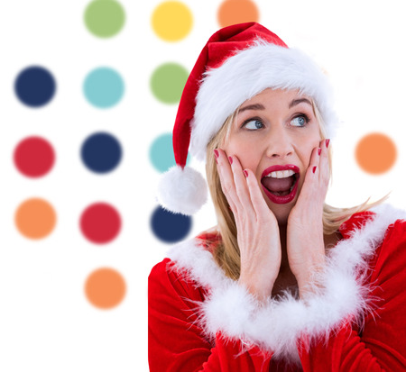 pere noel sexy: Blonds festive avec les mains sur le visage contre color� motif � pois