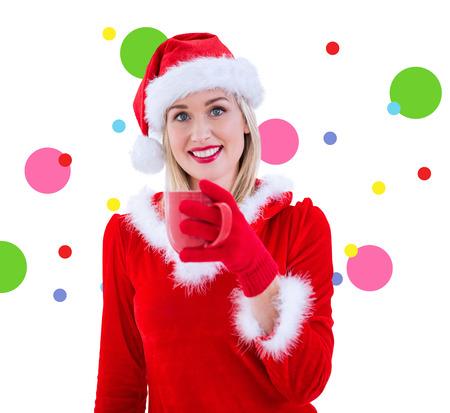pere noel sexy: Festive blonde holding a mug against dot pattern