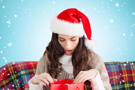 opening gift: Festive brunette opening gift against blue vignette