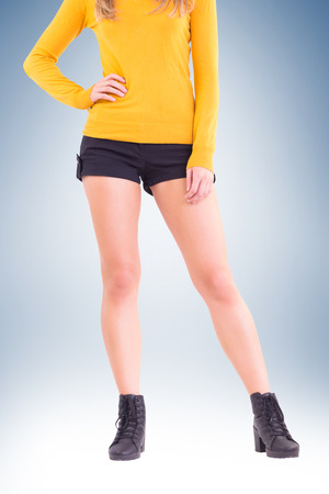 hot pants: Lower half of woman in boots and shorts on vignette background