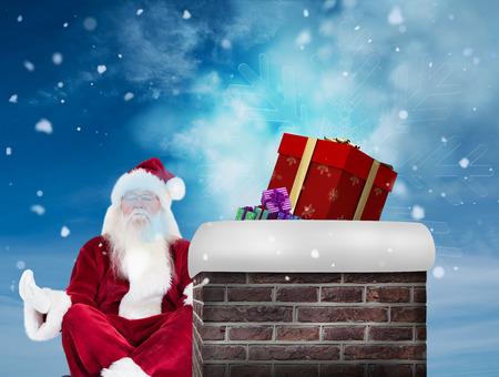meditates: Santa Claus sits and meditates against blue sky Stock Photo