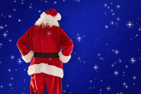 rear view: Rear view of father christmas against blue
