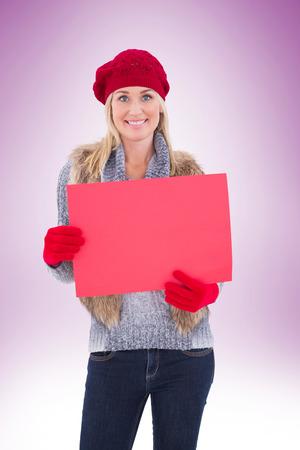 rood teken: Blonde in winter clothes holding red sign on vignette background