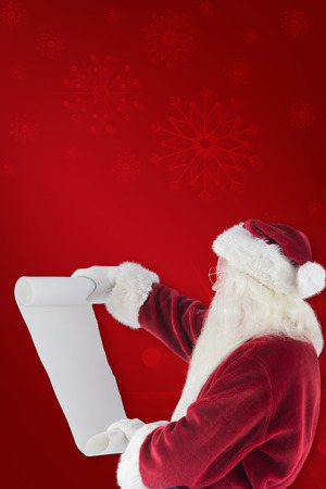 clear away: Santa Claus reads a list against red background