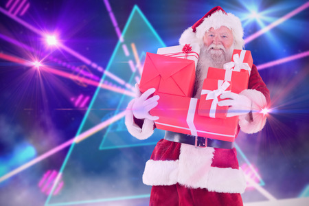 laser lights: Santa carries a few presents against digitally generated laser lights background