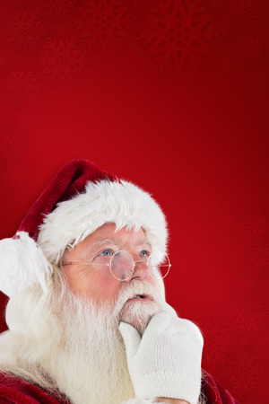 clear away: Santa is thinking about something against red background Stock Photo