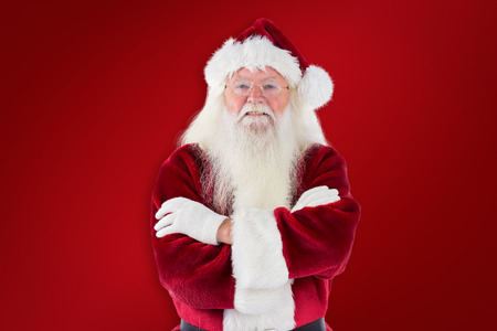 folded arms: Santa smiles with folded arms against red background