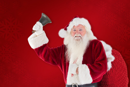 ring stand: Happy santa ringing a bell against red background Stock Photo