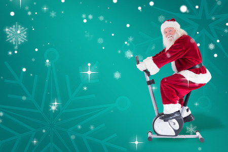home trainer: Santa uses a home trainer against green snowflake background