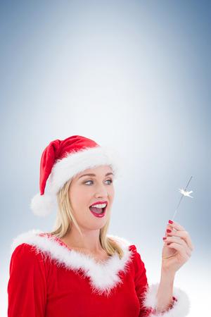 pere noel sexy: Festive blonds souriant � la main sur la vignette fond