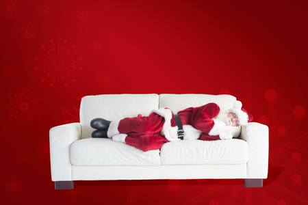 father christmas: Father Christmas sleeps on a couch against red background