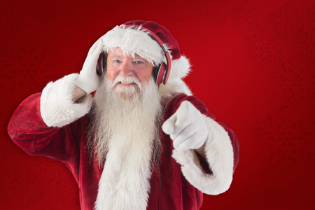Santa is listening some music against red background