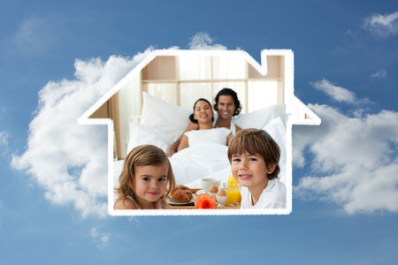 Siblings having breakfast with their parents against cloudy sky
