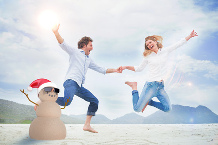 denim jeans: Festive sandman against cheerful couple holding hands and jumping at beach