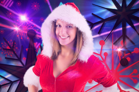 laser lights: Pretty brunette in santa outfit smiling at camera against digitally generated laser lights background