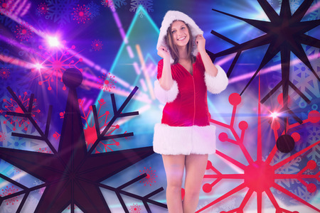 laser lights: Pretty santa girl smiling at camera against digitally generated laser lights background Stock Photo