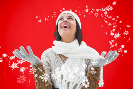 warm clothing: Brunette in warm clothing against red background
