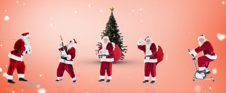 home trainer: Composite image of different santas against orange vignette Stock Photo