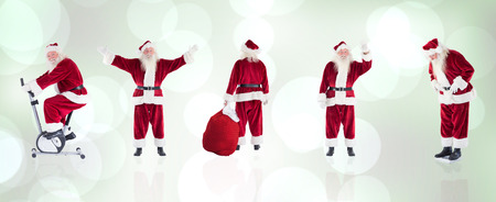 home trainer: Composite image of different santas against grey abstract light spot design Stock Photo