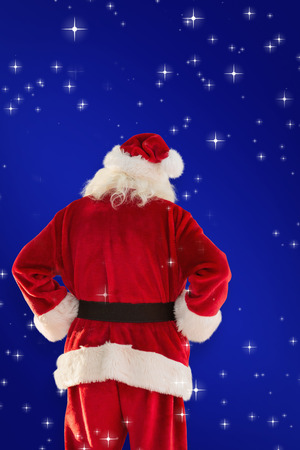 pere noel: Rear view of father christmas against blue