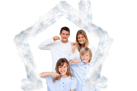 hygeine: Smiling young family brushing their teeths against house outline in clouds