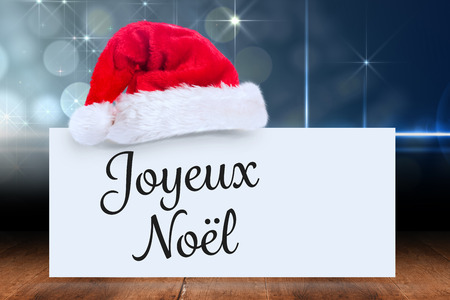 Joyeux noel against santa hat on poster