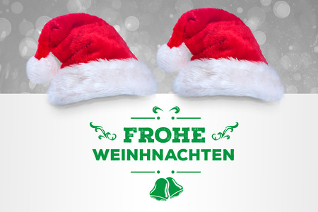 frohe: frohe weinhnachten against grey abstract light spot design Stock Photo