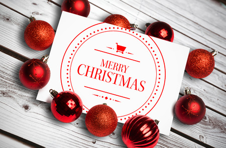 merry christmas: Banner and logo saying merry christmas against digitally generated grey wooden planks