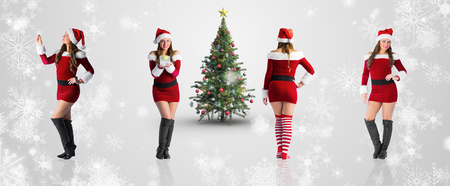 pere noel sexy: Image composite de diff�rents blondes festives contre la conception de flocon de neige blanc sur gris