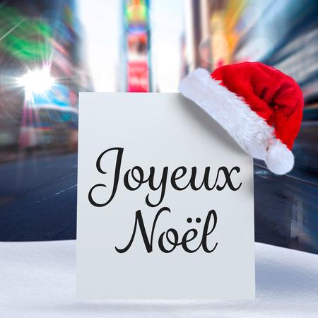 joyeux: Joyeux noel against blurry new york street Stock Photo