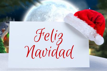 feliz navidad: Feliz navidad against quaint town with bright moon