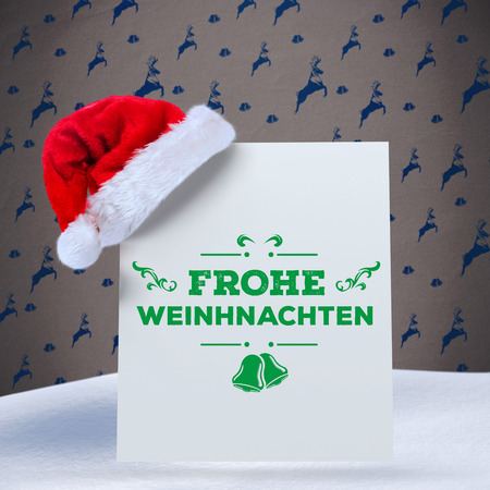 frohe: frohe weinhnachten against grey reindeer pattern Stock Photo