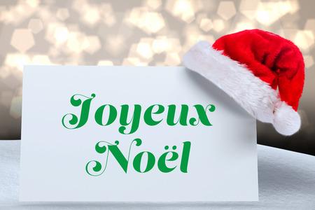 Joyeux noel against shimmering light design over boards