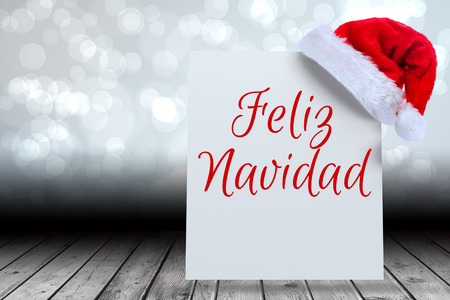feliz navidad: Feliz navidad against santa hat on poster Stock Photo