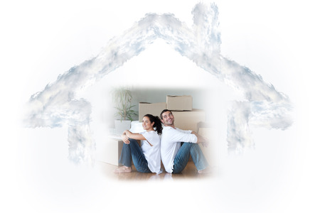 mortage: Glowing couple sitting on the floor against house outline in clouds