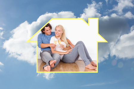 lovely couple: Composite image of lovely couple toasting against cloudy sky