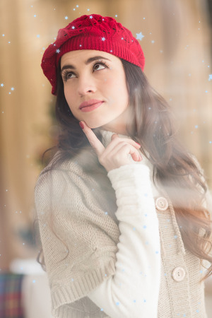day dreaming: Portrait of a brunette in day dreaming  against snow falling
