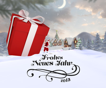 north pole: Santa delivering large gift against cute christmas village at north pole