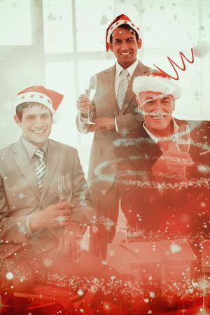 novelty: Confident businessmen wearing novelty Christmas hat against glittering christmas tree design